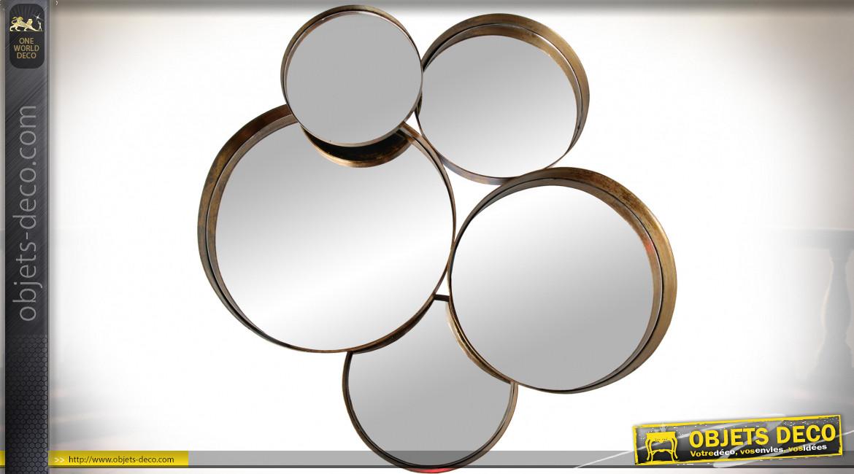 Décoration multi-miroirs ronds en métal doré avec important relief 66 cm