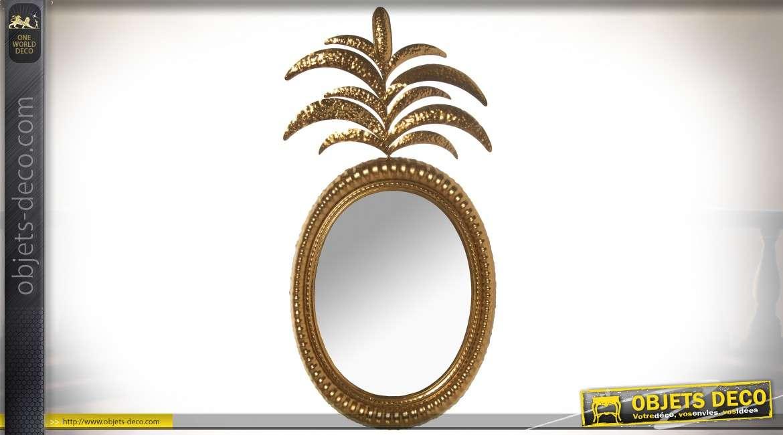 Grand miroir ovale doré avec feuilles de palmier stylisées 86 cm