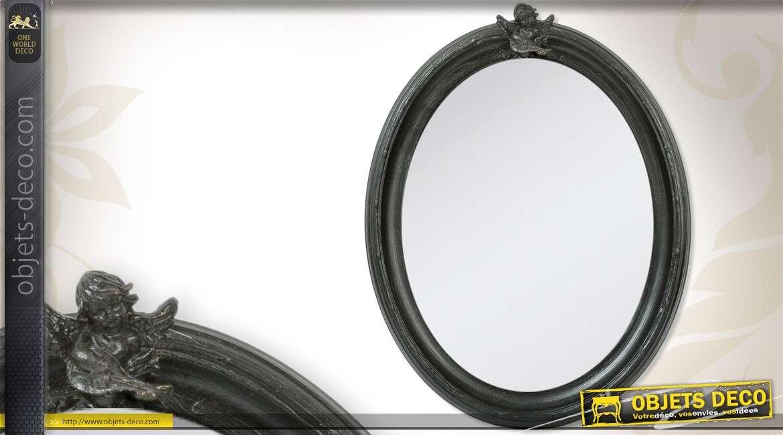 Miroir fen tre ronde en bois orn d 39 un motif fleuri for Miroir rond 40 cm