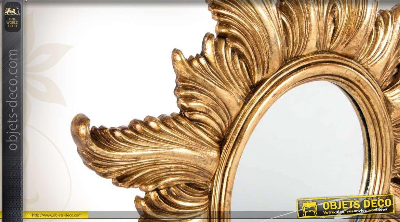 miroir mural en soleil coloris dor. Black Bedroom Furniture Sets. Home Design Ideas