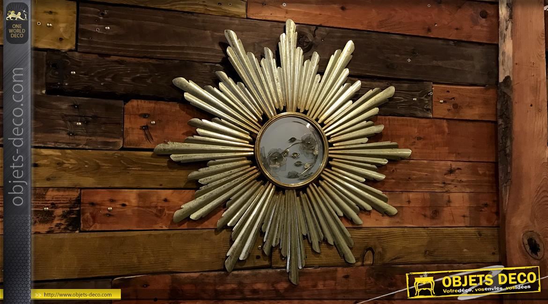 Miroir déco murale en métal soleil doré Ø 66 cm