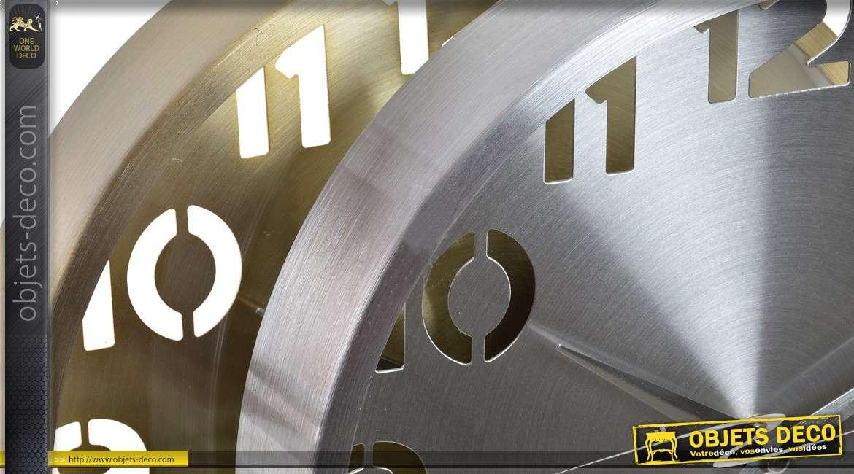 Série de deux horloges murales design en métal doré et argenté Ø 25 cm