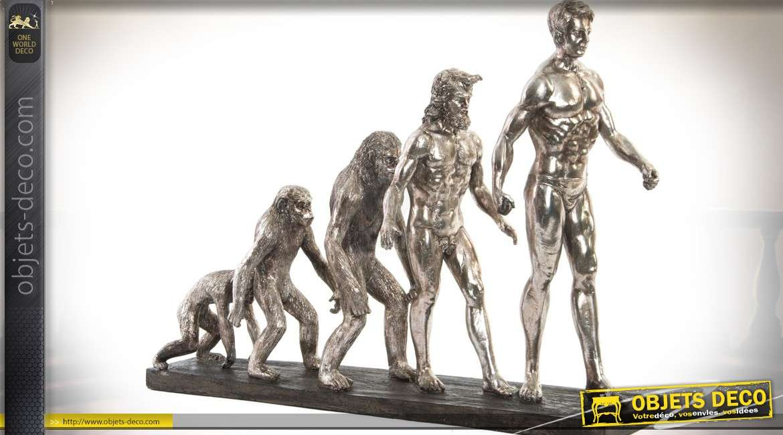 Statuette figurative L'évolution. En résine finition argentée 58 cm
