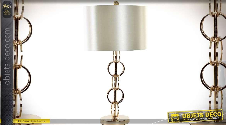 Lampe design métal doré motif anneaux et abat-jour cylindrique blanc satiné 73 cm