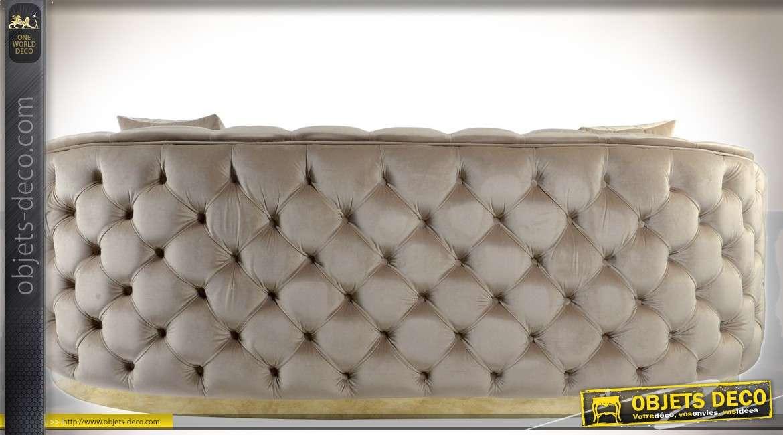 Grand canapé places style lounge chic tissu capitonné beige