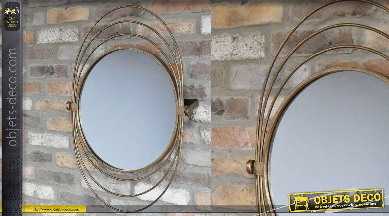 Miroir en métal de style moderne, modèle dit Saturne avec encadrement en anneaux, inclinable