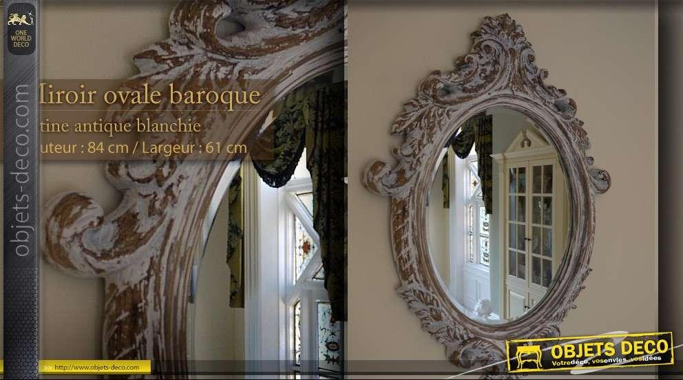 Miroir baroque ovale patine antique blanchie