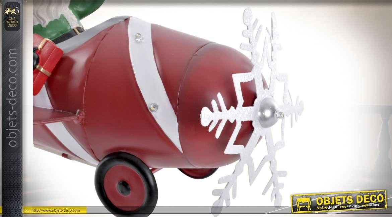 Représentation en métal du Père Noel dans un avion, éclairage LED intégré, 34cm