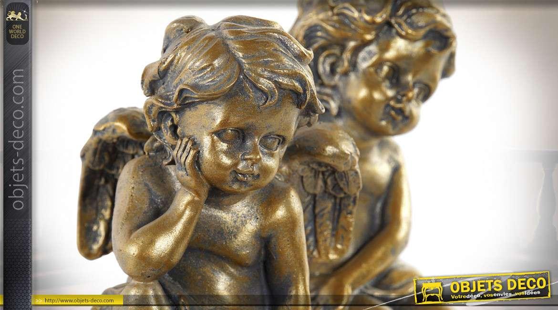 Série de deux petites statuettes anges finition dorée effet vieilli, 12cm