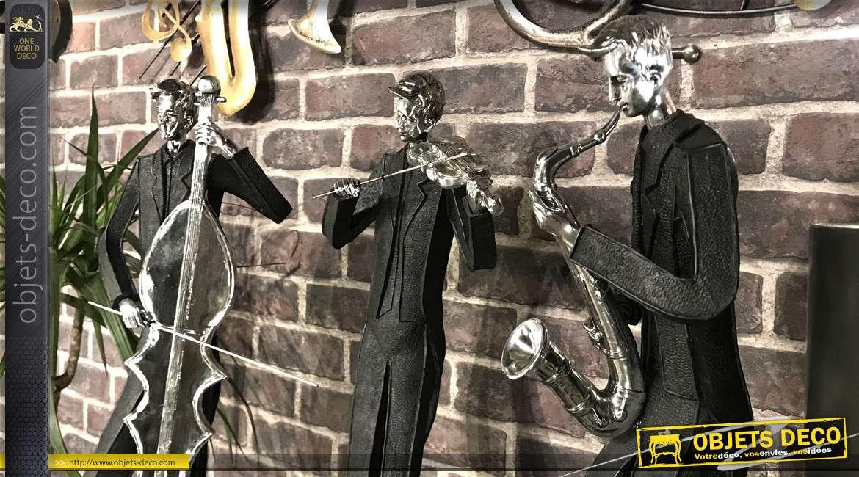 Grande statue en résine d'un saxophoniste, finition noir mat et vieil argent, 79cm de haut