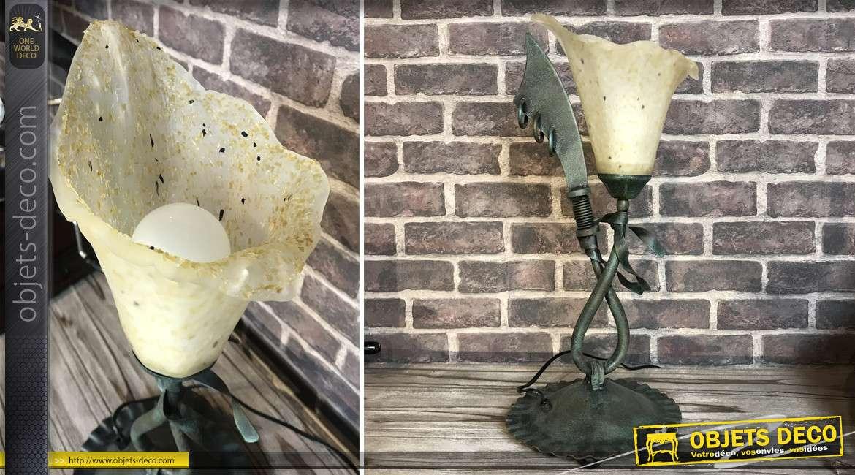 Lampe en verre et métal esprit ancienne piraterie, torche et sabre entrelacés, base ronde ondulée, finition vieux bronze, 51cm