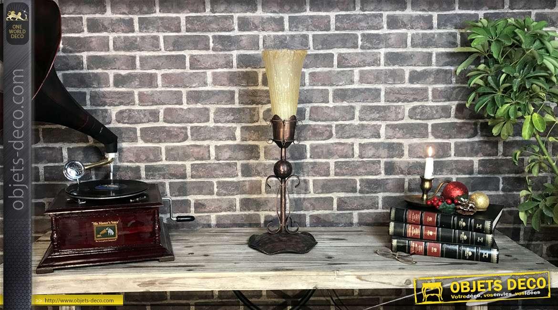 Lampe à poser en forme de torche médiévale, volutes baroques en métal et tulipe de verre, finition vieux rose et noir, 61cm