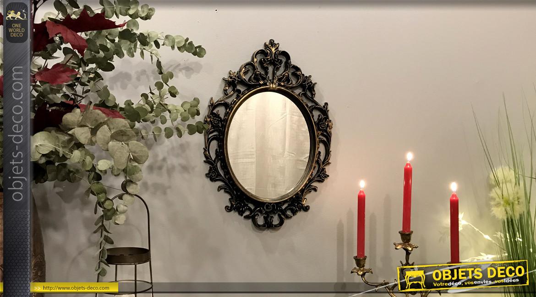 Miroir mural de forme ovale et de style baroque, effet résine finition noir charbon et reflets dorés, ambiance vieux chateaux, 52cm