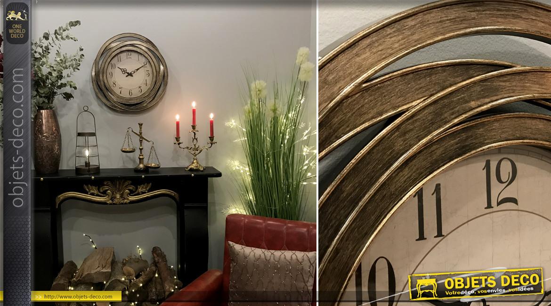 Horloge murale de style moderne, finition cuivrée effet brossé, encadrement esprit métal entrelacé, Ø50cm