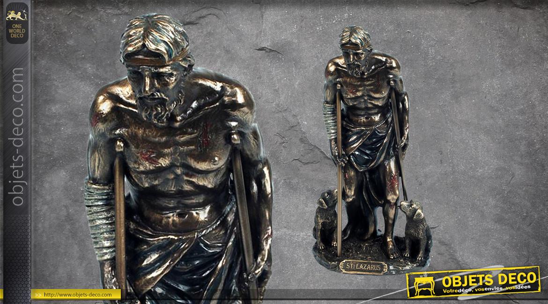 Saint Lazarre, représentation du premier ressucité avec bequilles et deux chiens, en résine finition laiton vieilli, collection Terre des Dieux, 20cm