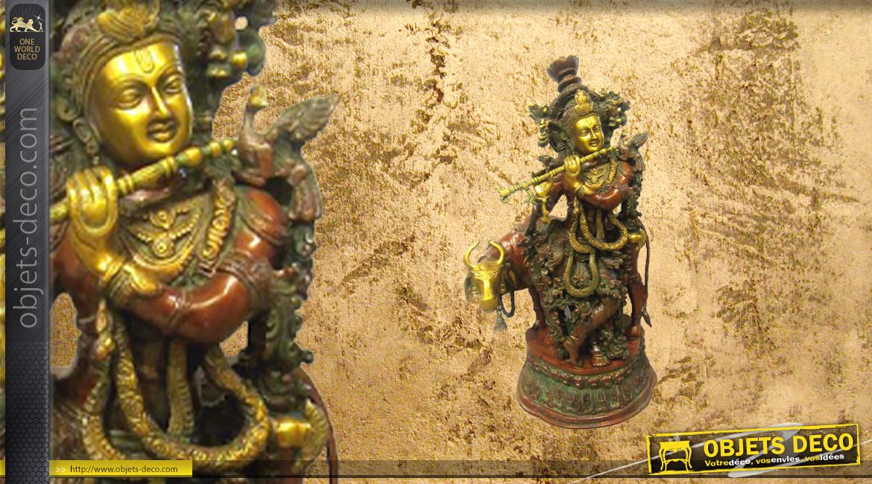 Représentation de Krishna en laiton massif, divinité assise sur un animal sacré, finitions effet anciennes, 30kg - 73cm