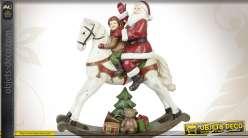 Décoration de Noël : Père-Noël avec enfant sur cheval à bascule