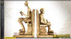 Paire de serre-livres en résine finition vieux doré