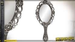 Miroir à main en métal finition argenté à motifs de fleurs en relief 18 cm