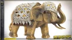 Statuette animalière éléphant doré avec harnachement à miroirs 18 cm