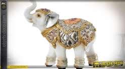 Statuette éléphanteau imitation porcelaine blanche avec ornementation dorée