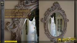 Miroir baroque ovale patine antique blanchie