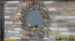 Grand miroir mural circulaire, encadrement papillons et finition vieux bronze avec reflets dorés, 82cm