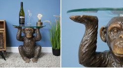 Table d'appoint en forme de singe, plateau épais en verre, finition brun vieilli, ambiance circus, Ø45cm