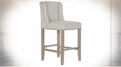 Chaise de bar en bois de caoutchouc finition naturelle, assise en lin beige et clous de tapissier, 100cm