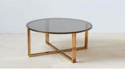 Table basse en acier doré et verre trempé teinté, de forme ronde, ambiance design moderne, Ø90cm