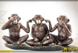 Statuette représentant 3 singes assis, finition imitation bronze cruivré antique