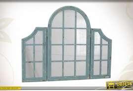 Miroir-fenêtre réalisé en bois coloris bleu patiné, et en verre, de style ancien.