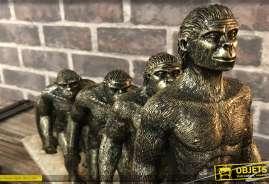 Statuette sur le thème de l'évolution, en résine haute densité finition effet bronze vieilli cuivré