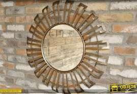 Grand miroir soleil stylisé en métal doré et cuivré