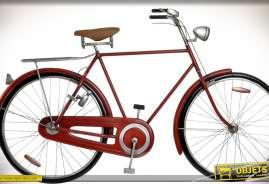 Création en métal, vélo rouge en relief pour décoration murale de style rétro.