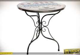 Table bistrot circulaire patine noire et plateau illustré à motifs vintages