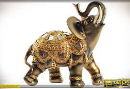 Statuette en résine et verre, imitation vieil or, bronze ancien, représentant un éléphant indien en harnachement d'apparât.