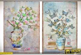 Deux tableaux en métal et en relief, en 80 x 60, représentant deux plantes à papillons, coloris vert clair et bleu ciel.