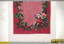 Serviette de cuisine illustrée d'un décor d'enfants faisant de la luge en période de Noël