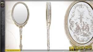 Miroir à main ornementé patiné coloris vieil argent