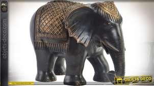 Statuette d'éléphant harnaché coloris ébène et or 37,5 cm