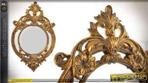 Miroir oval de style baroque patiné vieux doré 61 cm