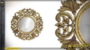 Miroir en bois sculpté finitions dorées vieillies Ø59