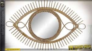 Miroir mural en rotin clair en forme d'oeil stylisé 71 cm