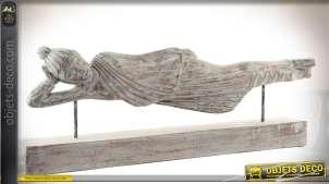 Statuette sculpté en bois d'un bouddha allongé sur son socle 78 cm