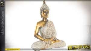Statuette de bouddha en position du lotus finition blanchie et dorée 27 cm