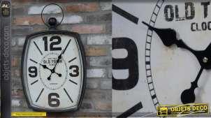 Horloge en métal, forme rectangulaire bombée avec anneau en son sommet, 76cm