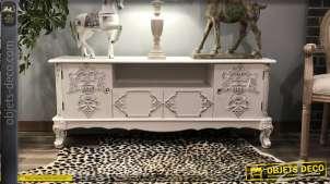 Meuble télé en bois de sapin, esprit baroques avec ornements floraux et pieds effet pates de lion, finition blanc doré, 138cm