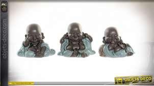 Série de trois petits moines en résine, ambiance voyage au Tibet, finition turquoise pastelle, 10cm