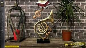 Trophée déco sur le thème de la musique avec instruments sur fond de portée de solfège, en métal, 46cm